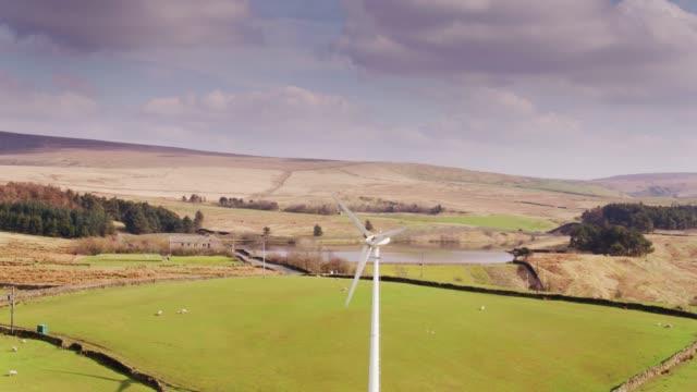 wind turbine in lancashire farmland - drone shot - lancashire stock videos and b-roll footage