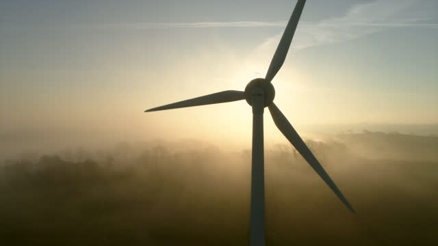 wind turbine in morning mist - beginnings stock videos & royalty-free footage