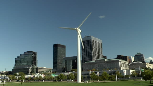 WS, Wind turbine in park, office buildings in background, Cleveland, Ohio, USA