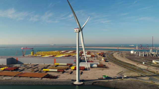 wind turbine in port - anlegestelle stock-videos und b-roll-filmmaterial