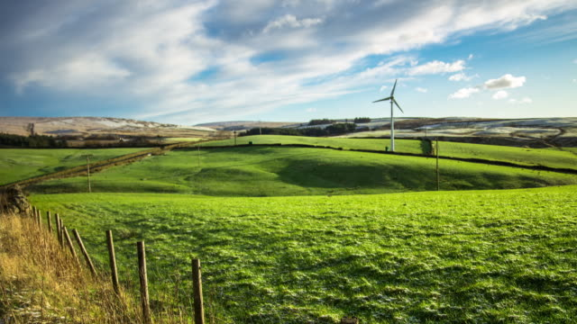 wind turbine in rural landscape - yorkshire england stock videos & royalty-free footage