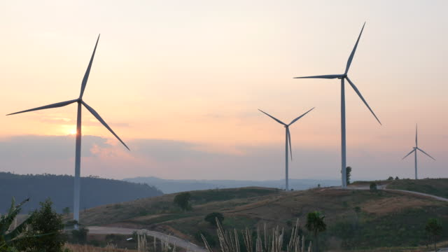 wind turbine in sunset - fuel and power generation stock videos & royalty-free footage