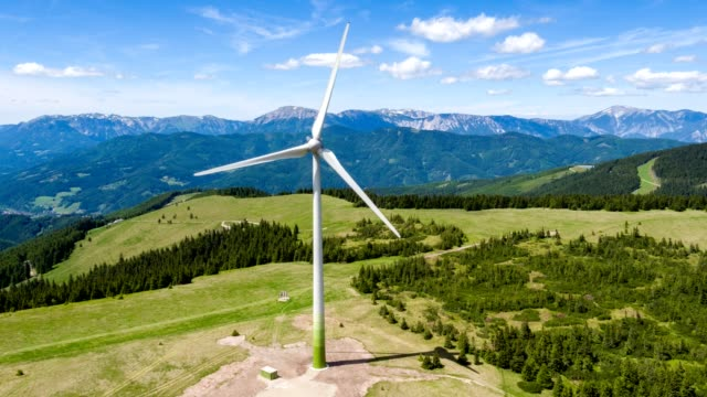 wind turbine in the alps - aerial view - source file cinema dng - austria stock videos and b-roll footage