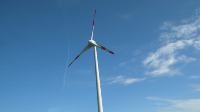 wind turbine of electric energy in netherlands road - opificio video stock e b–roll