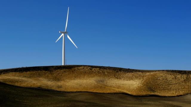 hd wind turbine on hill - single object stock videos & royalty-free footage