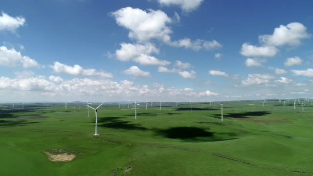 wind turbine on huitengxile grassland - 40 seconds or greater video stock e b–roll