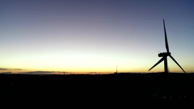 wind turbine on huitengxile grassland - 40 seconds or greater stock-videos und b-roll-filmmaterial