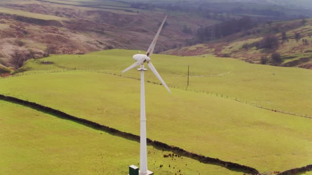 wind turbine on lancashire sheep farm - drone shot - yorkshire england stock videos & royalty-free footage