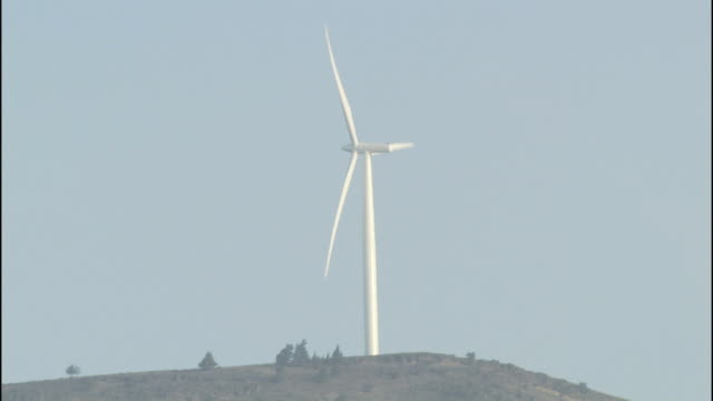 a wind turbine operates at the klondike wind farm in oregon. - klondike stock videos and b-roll footage