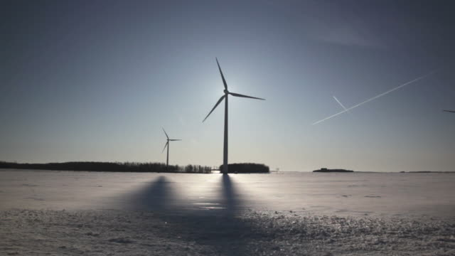 stockvideo's en b-roll-footage met wind turbine silhouette and shadow - canada