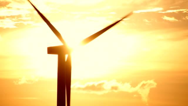 wind turbine turning at sunrise - turbine stock videos & royalty-free footage