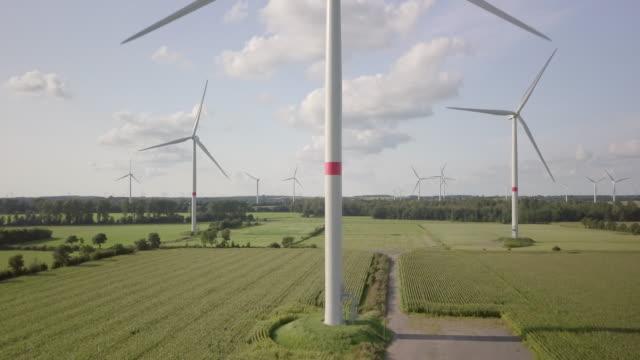 wind turbine turning gently in the wind - schleswig holstein stock-videos und b-roll-filmmaterial