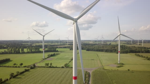 wind turbine turning gently in the wind - large group of objects stock videos & royalty-free footage
