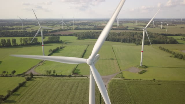 wind turbine turning gently in the wind - schleswig holstein stock videos & royalty-free footage
