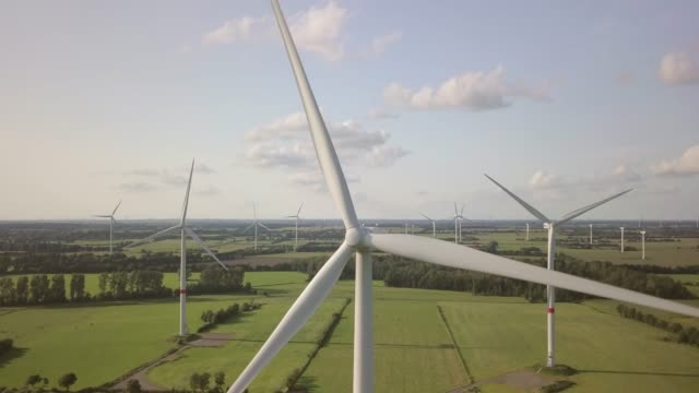 wind turbine turning gently in the wind - alternative energy stock videos and b-roll footage
