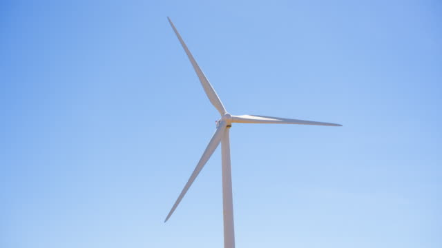 wind turbine turning in the wind - mgost stock videos and b-roll footage