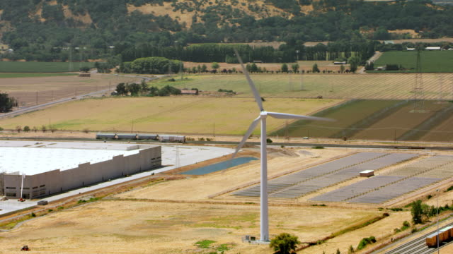 aerial wind turbine turning on a sunny day in california - renewable energy stock videos & royalty-free footage