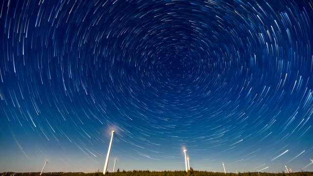 stockvideo's en b-roll-footage met t/l ws wind turbine under the sky with star trail / hebei, china - lichtspoor lange sluitertijd