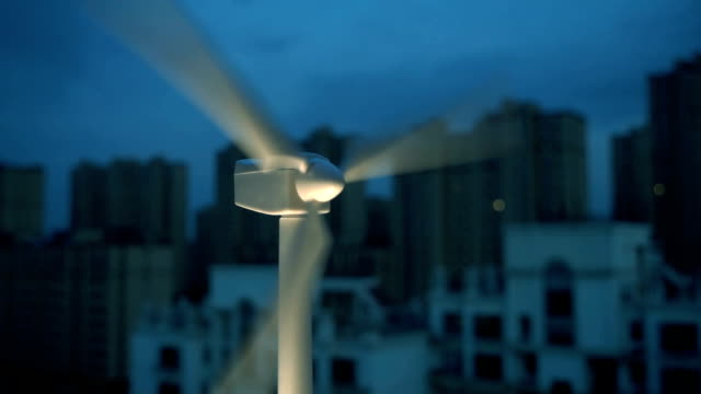 Wind turbine with city background