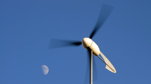 wind turbine with moon hd - small stock videos & royalty-free footage