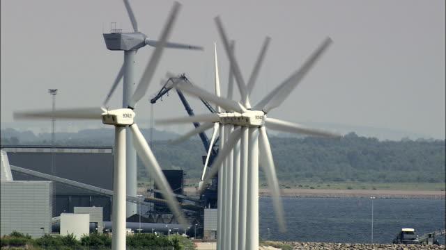 wind turbines - aerial view - capital region, hvidovre kommune, denmark - capital region stock videos & royalty-free footage