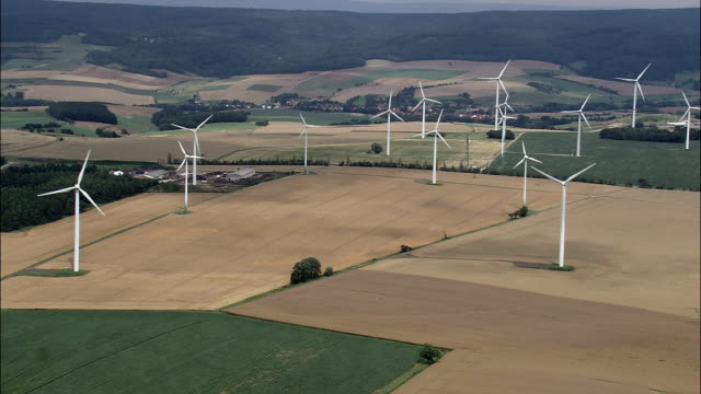wind turbines  - aerial view - thuringia,  helicopter filming,  aerial video,  cineflex,  establishing shot,  germany - turingia video stock e b–roll