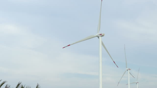 wind turbines against blue sky - electrical equipment stock videos & royalty-free footage