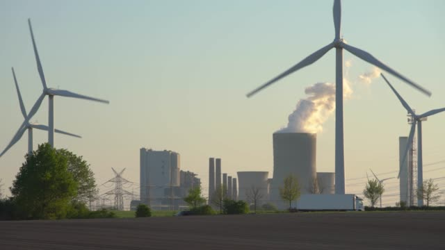 wind turbines and power station - coal fired power station stock videos & royalty-free footage