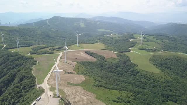 wind turbines and samyang ranch in daegwallyeong township / pyeongchang-gun, gangwon-do, south korea - generator stock videos & royalty-free footage