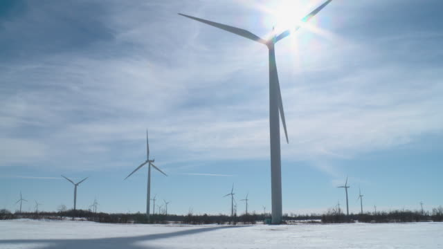 WS TD Wind turbines and shadows of blades in winter / Kingston, Ontario, Canada