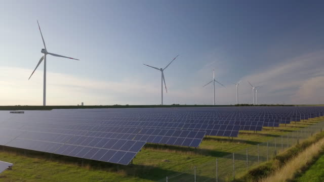 wind turbines and solar plant - environmental conservation stock videos & royalty-free footage