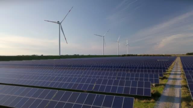 wind turbines and solar plant - deutsche nordseeregion stock-videos und b-roll-filmmaterial