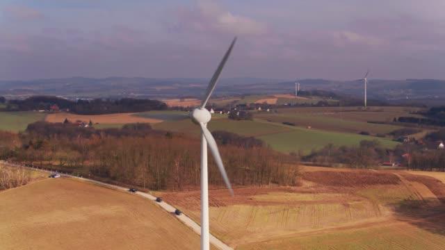 wind turbines and telecommunications tower in north german farmland - aerial view - north rhine westphalia stock videos & royalty-free footage