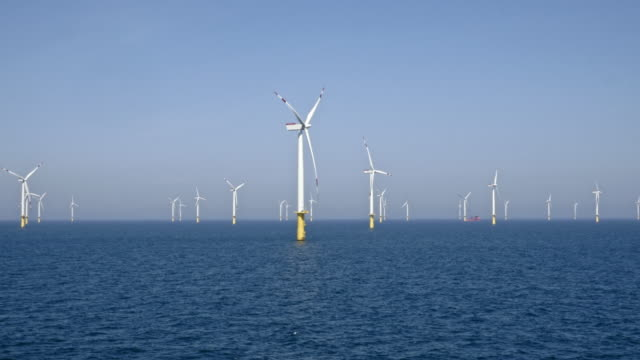 aerial wind turbines at an offshore wind farm - turbine stock videos & royalty-free footage