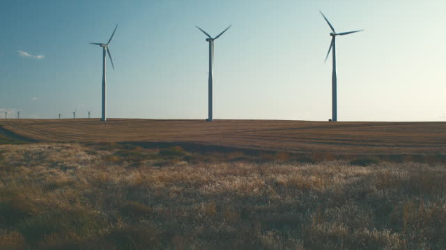 ws wind turbines at dusk / zillah, washington, usa        - medium group of objects stock videos & royalty-free footage