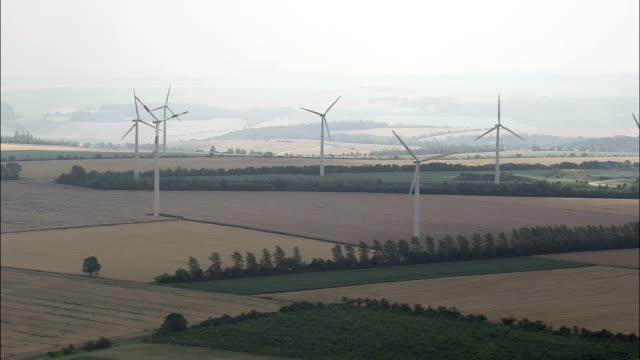 wind turbines at eckolstadt  - aerial view - thuringia,  helicopter filming,  aerial video,  cineflex,  establishing shot,  germany - turingia video stock e b–roll