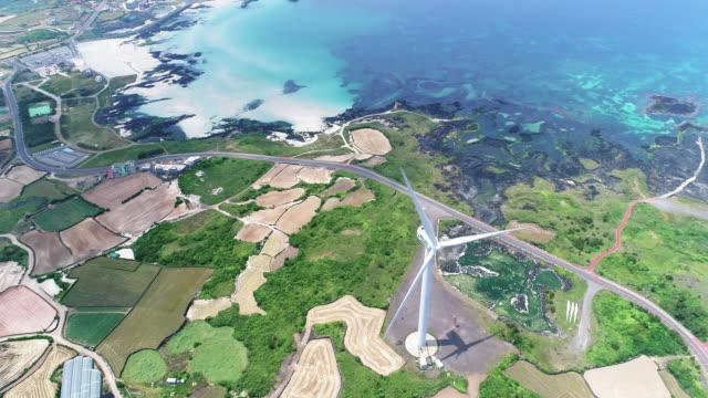 wind turbines at gimnyeong seonsegi beach / gujwa-eup, jeju-si, jeju-do, south korea - elevated view stock videos & royalty-free footage