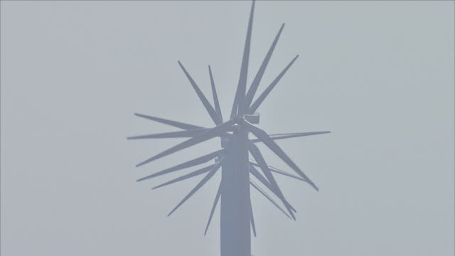 wind turbines at offshore wind farm - sustainable resources stock videos and b-roll footage