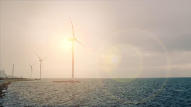 stockvideo's en b-roll-footage met wind turbines op zee - windenergie