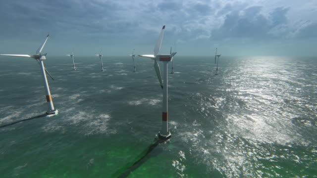 wind turbines at sea / wind farm - idyllic stock videos & royalty-free footage