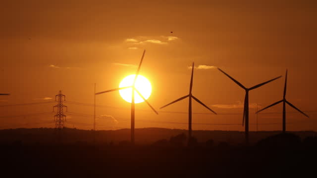 wind turbines at sunset in little cheyne court wind farm near camber, england, u.k., on wednesday, october 28, 2020. - sun stock videos & royalty-free footage