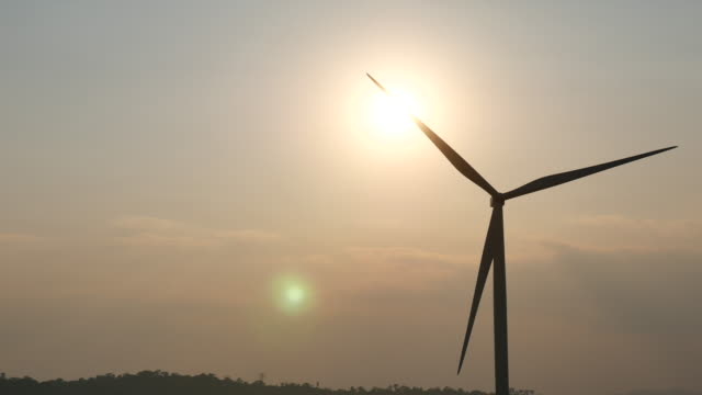 wind turbines at sunset, renewable energy - windmill stock videos and b-roll footage