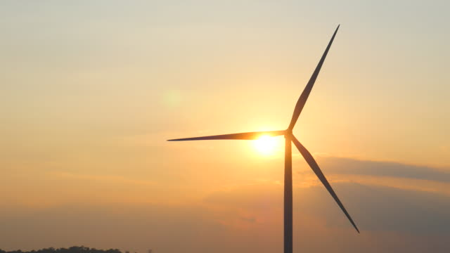 wind turbines at sunset, renewable energy - single object stock videos & royalty-free footage