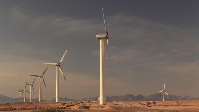 wind turbines at sunset sky background - hurghada stock-videos und b-roll-filmmaterial