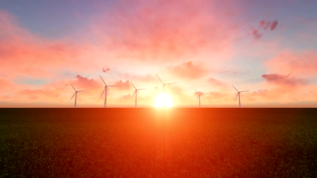 wind turbines at sunset sky background - power equipment stock videos & royalty-free footage