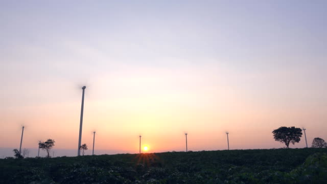 wind turbines at sunset, time lapse - generator stock videos & royalty-free footage