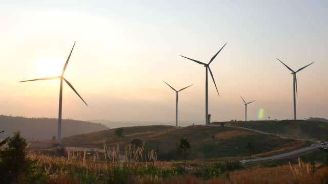 wind turbines at sunset - fuel and power generation stock videos & royalty-free footage