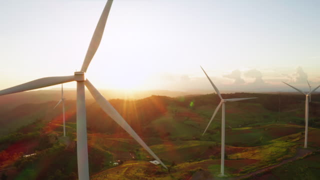 wind turbines at sunset - sunny stock videos & royalty-free footage