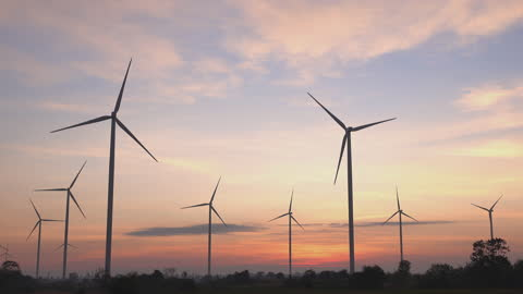 wind turbines at sunset. - wind power stock videos & royalty-free footage