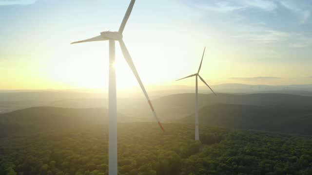 wind turbines at sunset - hill stock videos & royalty-free footage